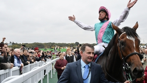 Frankie Dettori basks in the applause after Enable's second Arc success