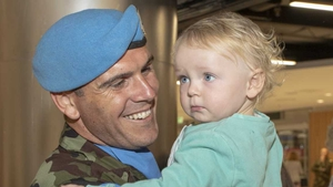 Corporal Dave Sweeney and his son Daíre at Dublin Airport