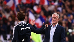 Antoine Griezmann celebrates with coach Didier Deschamps