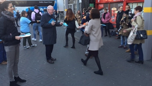 Charlie Flanagan handing out leaflets this morning