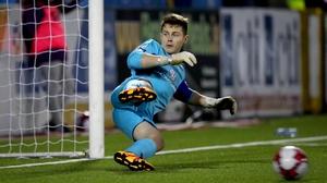 Sligo goalkeeper Ed McGinty is beaten by the penalty of Patrick Hoban