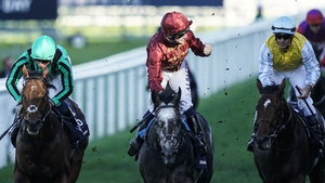 Oisin Murphy celebrates after riding Roaring Lion (C, maroon) to win The Queen Elizabeth II Stakes at Ascot