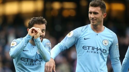 Bernardo Silva (L) of Manchester City celebrates after scoring his team's second goal