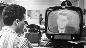 Federico Fidel Fernandez, a Miami Cuban refugee, listens to President Kennedy's television address 22nd October 1962, in which the President explained the United States' position on the Cuban situation to the American people and the world.