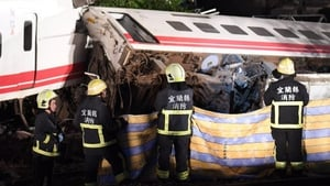 Rescue teams work to remove those injured in the derailment