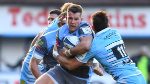 Jason Harries of Cardiff Blues is tackled by DTH Van Der Merwe of Glasgow Warriors during their European clash