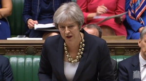Theresa May said that a short extension of a planned transition period following Brexit might be needed