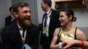 Conor McGregor and Katie Taylor share a joke at the weekend