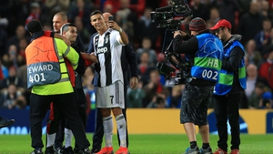 Ronaldo takes a selfie with one of the Old Trafford pitch invaders