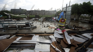 A resident salvages belongings from the rubble of a building in the city of Escuinapa in Sinaloa state
