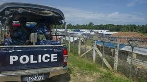 Myanmar police patrol a Rohingya camp on the border with Bangladesh