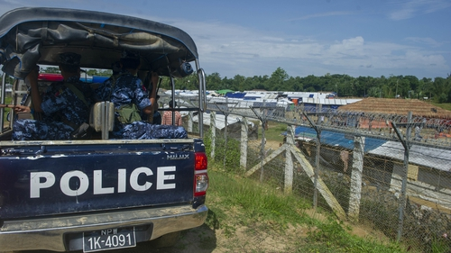 Myanmar police patrol a Rohingya camp on the border with Bangladesh