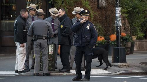 Police gather outside Robert De Niro's New York restaurant