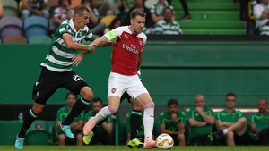 Aaron Ramsey in action against Sporting