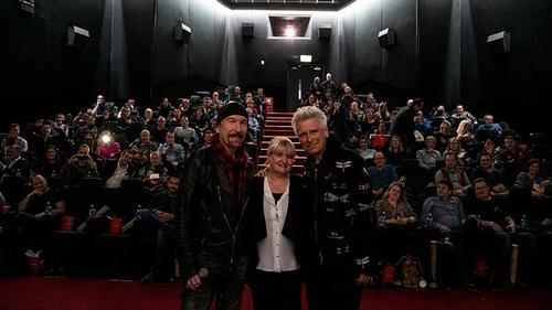 The Edge and Adam Clayton with Savoy Cinema's Sandra O'Donoghue