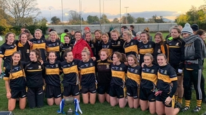 Mourneabbey pose with the trophy (photo: @MourneabbeyLFC)
