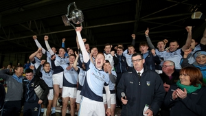 Na Piarsaigh's William O'Donoghue lifts the John Daly Cup