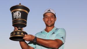 Xander Schauffele with the trophy