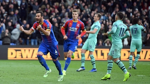 Luka Milivojevic celebrates blasting home his second penalty at home to Arsenal this afternoon