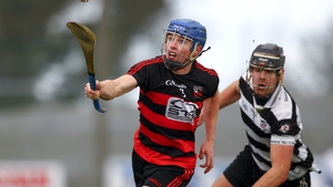 Ballygunner's Tim O'Sullivan pursued by Midleton's Finbar O'Mahoney