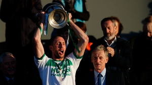Michael Fennelly holds aloft the Tom Walsh Cup as Ballyhale Shamrocks win it back for the first time since 2014