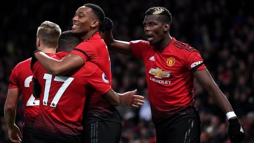 Anthony Martial is mobbed after his goal for Manchester United