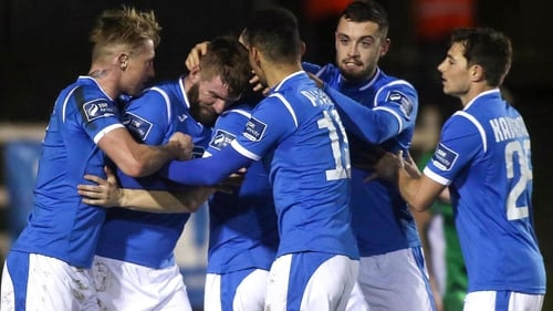 Paddy McCourt is congratulated by his team-mates after scoring