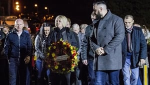 Daughter of John Burns, Gillian holding a wreath during a vigil to mark the 25th anniversary of the UFF attack