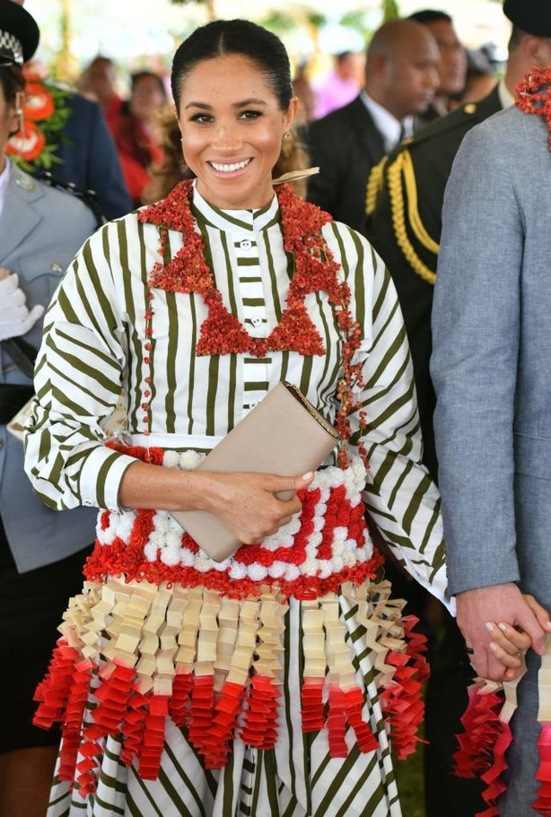The Duchess of Sussex at an exhibition of Tongan handicrafts, mats and tapa cloths at the Fa'onelua Convention Centre (PA)