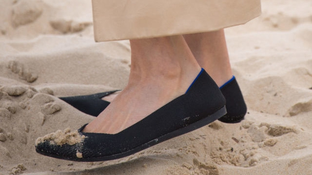 Sand on the Duchess of Sussex's shoes as she walks on South Melbourne Beach (PA)