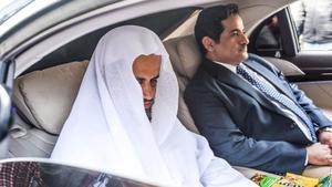 The head of the Saudi investigation, Attorney General Sheikh Saud al-Mojeb (L), leaves the Saudi Arabian consulate in Istanbul