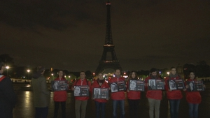 Members of French NGO Reporters Without Borders gathered in front of the Paris landmark