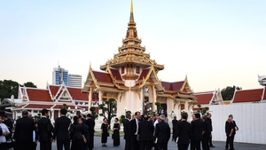 Mourners arrive at the Wat Thepsirin Buddhist temple in Bangkok for the funeral ceremony of Vichai Srivaddhanaprabha