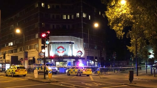 Police outside Clapham South tube station after a 17-year-old boy was fatally stabbed