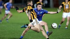 Crossmaglen's Rico Kelly with Cormac O'Hagan of Coalisland