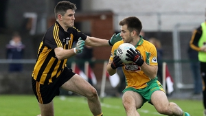 Corofin's Cathal Silke and Barry McHugh of Mountbellew-Moylough