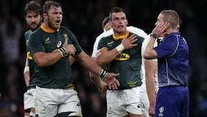 Referee Angus Gardner (R) decided Farrell had attempted to wrap his arms in the tackle