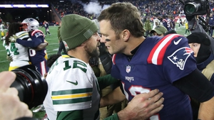 Tom Brady greets Aaron Rogers after the game