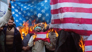 Iranian protesters burned the US flag on the eve of renewed sanctions by Washington