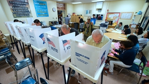 People cast their ballots at a school in Los Angeles, California