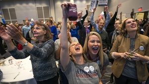 Supporters of Democratic House candidate Sharice Davids cheer after learning of her election