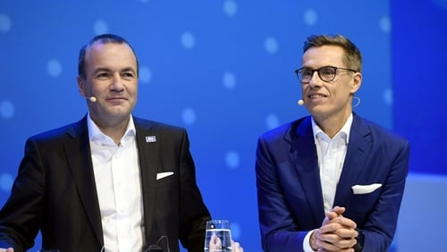 Manfred Weber (L) and Alexander Stubb take part in a debate at the EPP's congress in Helsinki