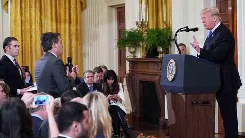 President Trump clashes with CNN journalist Jim Acosta (C) and NBC's Peter Alexander (L), who came to Mr Acosta's defence
