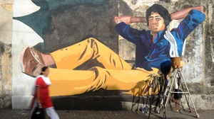 Mural on a Mumbai wall of Bollywood actor Amitabh Bachchan from his classic film Deewar. Photo: Indranil Mukherjee/AFP/ Getty Images