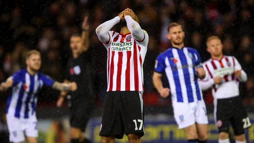 David McGoldrick reacts to his penalty miss