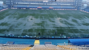 Water lies on the surface of La Bombonera Stadium in Buenos Aires
