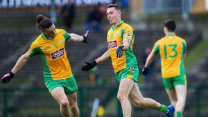 Jason Leonard and Kieran Molloy celebrate the former's opening goal in their one-sided win over Clann na nGael
