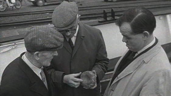 Men with an allegedly unlucky stone, Wexford Quays (1968)