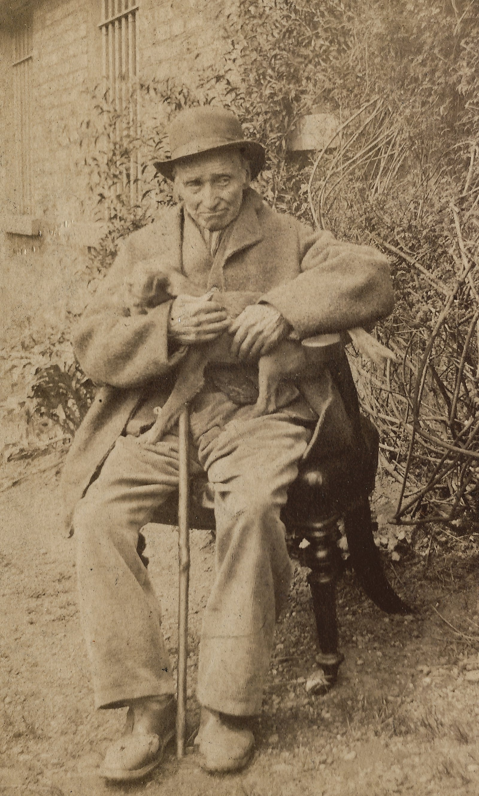 Image - Albumen portrait of James Conway seated outside with cane and hat.