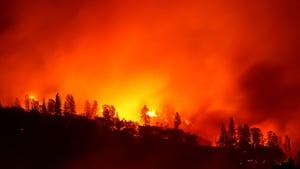 The Camp Fire burns in the hills near Oroville, California